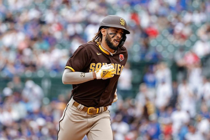 May 31, 2021; Chicago, Illinois, USA; San Diego Padres shortstop Fernando Tatis Jr. (23) rounds the bases after hitting a solo home run against the Chicago Cubs during the sixth inning at Wrigley Field.