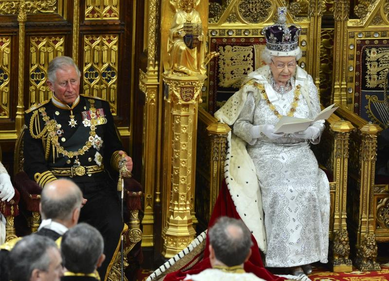 Britain's Queen Elizabeth delivers her speech during the State Opening of Parliament at the House of Lords, alongside Prince Charles in London Wednesday May 8, 2013. The State Opening of Parliament marks the formal start of the parliamentary year, the Queen delivered a speech which set out the government's agenda for the coming year. (AP Photo/Toby Melville, Pool)
