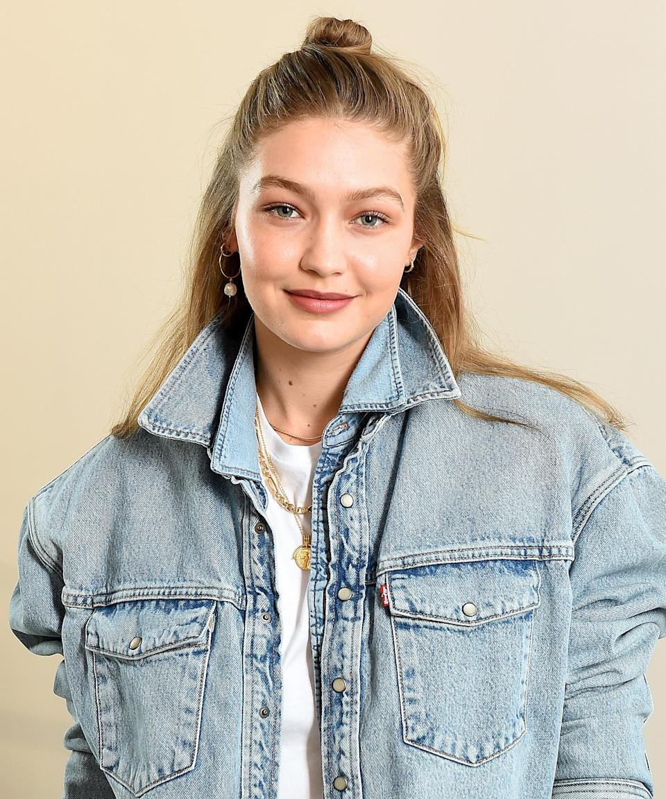 """Gigi's biggest beauty moments may be from the red carpet or runway, but some of her best looks come from her off-duty hours. See: Her barefaced, dewy glow and topknot updo in New York City. <span class=""""copyright"""">Photo: Ilya S. Savenok/Getty Images.</span>"""