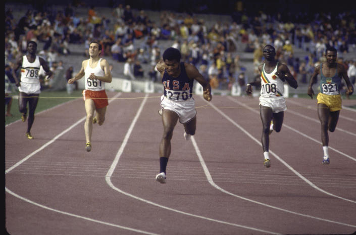 US athlete Lee Evans (C) going through finish line during race at Summer Olympics.  (Photo by Bill Eppridge/The LIFE Picture Collection via Getty Images)