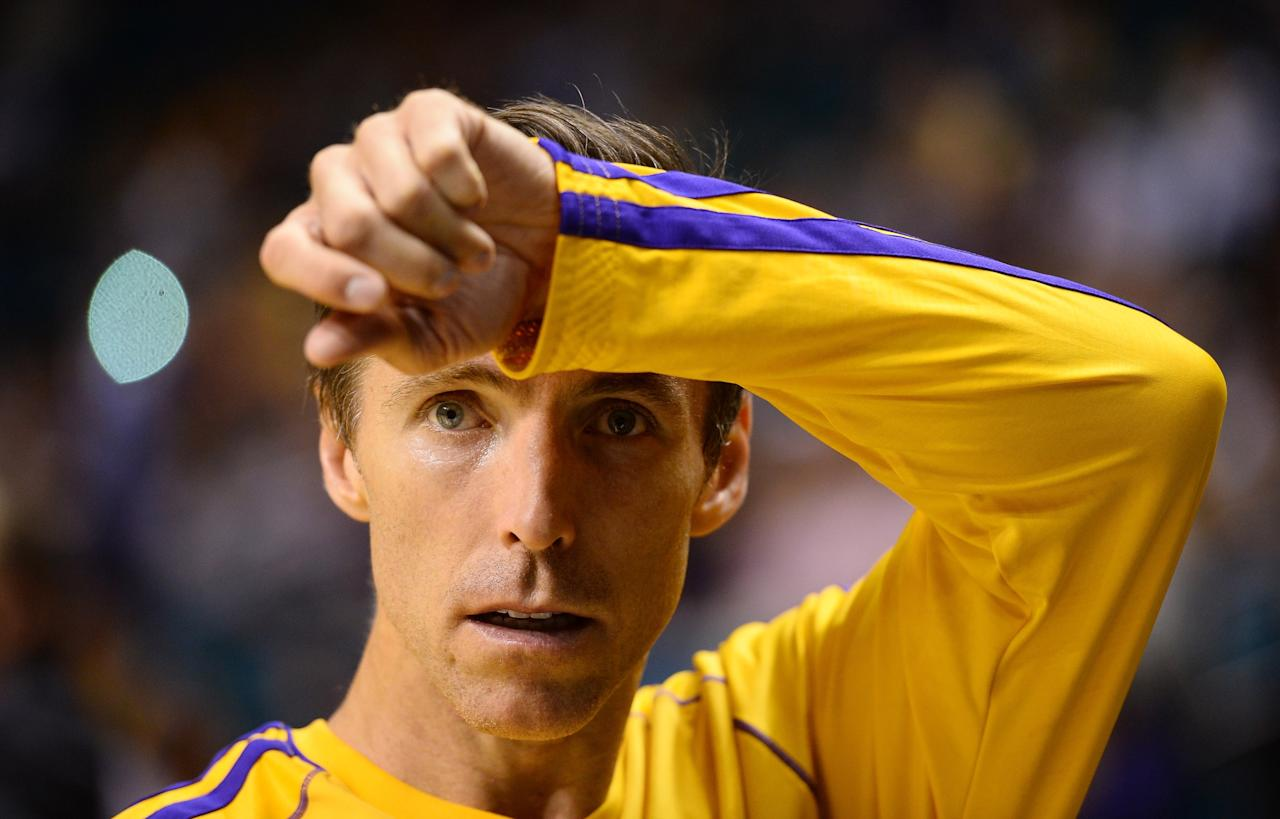 LAS VEGAS, NV - OCTOBER 10: Steve Nash #10 of the Los Angeles Lakers wipes his brow during warmups before a preseason game against the Sacramento Kings at the MGM Grand Garden Arena on October 10, 2013 in Las Vegas, Nevada. NOTE TO USER: User expressly acknowledges and agrees that, by downloading and or using this photograph, User is consenting to the terms and conditions of the Getty Images License Agreement. (Photo by Ethan Miller/Getty Images)