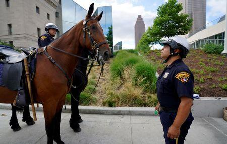 Cleveland mounted police officer Abraham Cortes talks to his horse Paco during a demonstration of police capabilities near the site of the Republican National Convention