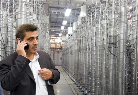 An official from Iran's Atomic Energy Organization speaks on his mobile phone at an exhibition of Iran's nuclear achievements at Shahid Beheshti University in Tehran