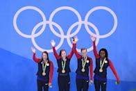 <p>Kathleen Baker, Lilly King, Dana Vollmer, Simone Manuel of the United States celebrate on the podium during the medal ceremony for the Women's 4 x 100m Medley Relay Final on Day 8 of the Rio 2016 Olympic Games at the Olympic Aquatics Stadium on August 13, 2016 in Rio de Janeiro, Brazil. (Photo by Richard Heathcote/Getty Images) </p>