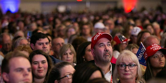 Supporters listen as former US President Donald Trump speaks at the Conservative Political Action Conference (CPAC) in Dallas, Texas on July 11, 2021.