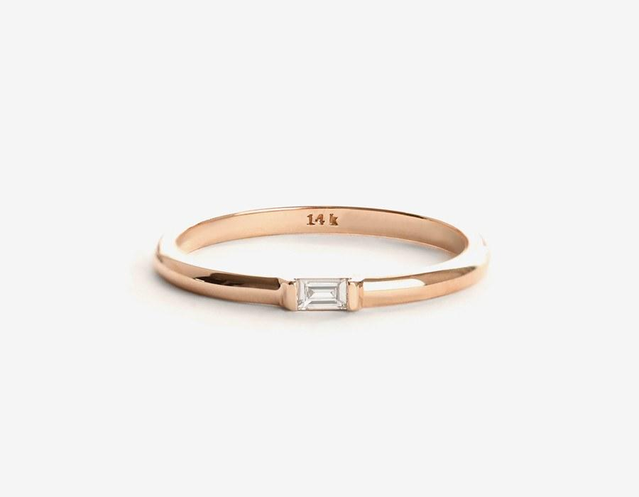 """<p><em>Baguette diamond ring, $295, <a rel=""""nofollow"""" href=""""https://vraiandoro.com/collections/rings/products/baguette-diamond-ring-rose?mbid=synd_yahoostyle"""">Vrai & Oro</a></em></p>"""