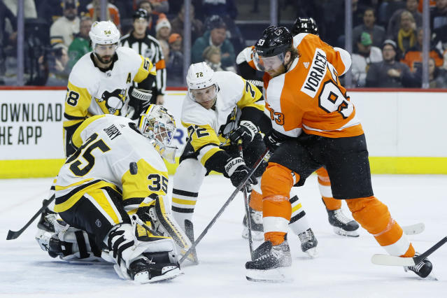 Philadelphia Flyers' Jakub Voracek (93) cannot get a shot past Pittsburgh Penguins' Tristan Jarry (35) and Patric Hornqvist (72) during the second period of an NHL hockey game, Tuesday, Jan. 21, 2020, in Philadelphia. (AP Photo/Matt Slocum)