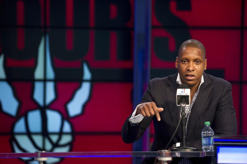 Toronto Raptors president and general manager Masai Ujiri address the media during an NBA basketball news conference, Tuesday, May 6, 2014. Raptors coach Dwane Casey  agreed to a three-year contract extension after Toronto won a franchise-record 48 games this season