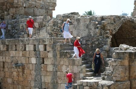 Tourists walk down the stairs at the sea castle in the port city of Sidon