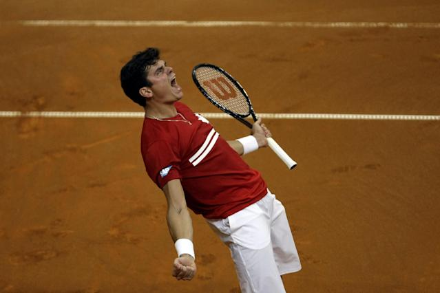 Canada's Milos Raonic screams with joy as he wins his Davis Cup semifinals tennis match against Serbia's Janko Tipsarevic in Belgrade, Serbia, Friday, Sept. 13, 2013. (AP Photo/ Marko Drobnjakovic)