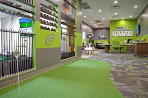GOLFTEC lobby, putting green and club fitting wall