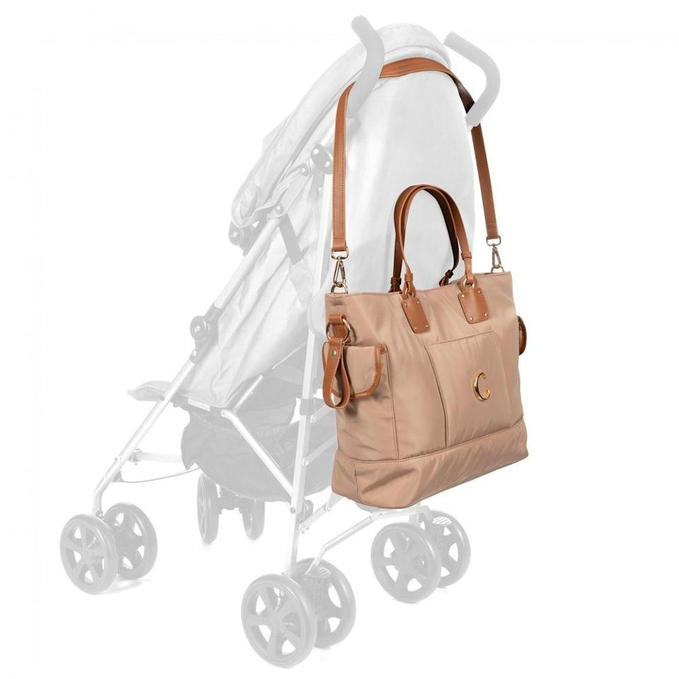 """<p><strong>Chloé</strong></p><p>childrensalon.com</p><p><strong>$660.00</strong></p><p><a href=""""https://www.childrensalon.com/chloe-beige-changing-bag-45cm-383515.html"""" rel=""""nofollow noopener"""" target=""""_blank"""" data-ylk=""""slk:Shop Now"""" class=""""link rapid-noclick-resp"""">Shop Now</a></p><p>A newborn doesn't have to mean giving up luxury fashion. Chloé's version of a diaper bag looks more like a purse with leather handles and has a simple design made with cleanable nylon. It comes with a mat and multiple pockets, inside and out, for all those random baby needs.</p>"""