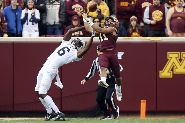 Minnesota defensive back Antoine Winfield Jr. (11) intercepts the ball intended for Penn State wide receiver Justin Shorter (6) during an NCAA college football game, Saturday, Nov. 9, 2019, in Minneapolis. (AP Photo/Stacy Bengs)