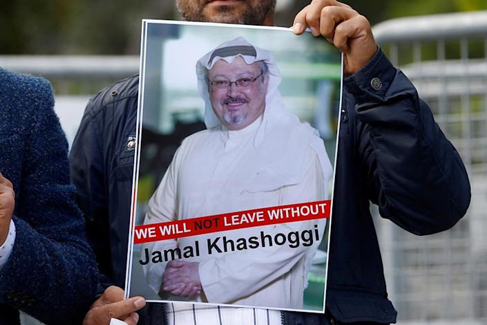 Protesters in Istanbul hold a picture of the missing journalist outside the Saudi consulate (Reuters)