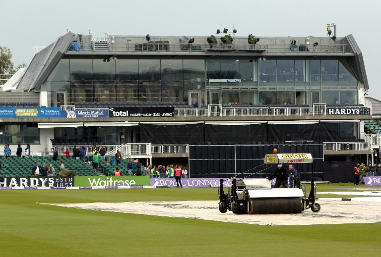 Covers protect the square from rain, which is delaying the start of the first one-day international (ODI) between England and India at the County Ground in Bristol, south-west England, on August 25, 2014