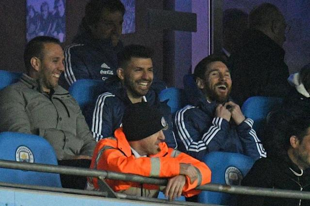 Sidelined: Lionel Messi sits with Sergio Aguero as Argentina beat Italy 2-0 in Manchester