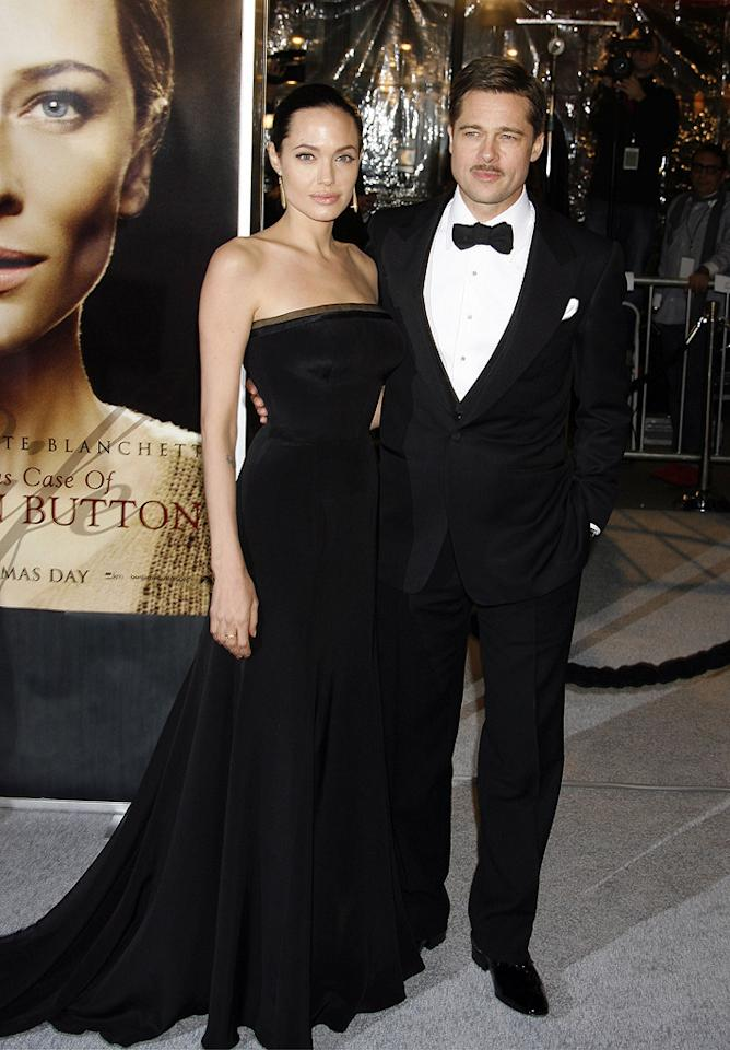 """<a href=""""http://movies.yahoo.com/movie/contributor/1800019275"""">Angelina Jolie</a> and <a href=""""http://movies.yahoo.com/movie/contributor/1800018965"""">Brad Pitt</a> at the Los Angeles premiere of <a href=""""http://movies.yahoo.com/movie/1809785152/info"""">The Curious Case of Benjamin Button</a> - 12/08/2008"""