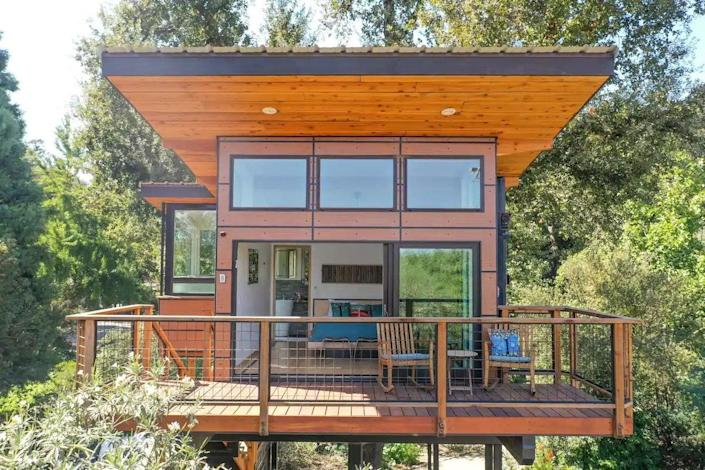 """<p><strong>Visalia, California</strong></p> <p>For a modern, design-forward treehouse experience, look no further than this luxury treehouse with views of the Sierras, planted steps away from a 300-acre almond farm. The treehouse bedroom has a beautiful wood <a href=""""https://www.architecturaldigest.com/gallery/best-bed-frames-2021?mbid=synd_yahoo_rss"""" rel=""""nofollow noopener"""" target=""""_blank"""" data-ylk=""""slk:bed frame"""" class=""""link rapid-noclick-resp"""">bed frame</a> with a Casper mattress and a cozy fireplace for cool evenings. Take nature walks around the area with chance encounters of opossums, red-tailed hawks, owls, and red foxes.</p> $275, Airbnb. <a href=""""https://www.airbnb.com/rooms/33828372"""" rel=""""nofollow noopener"""" target=""""_blank"""" data-ylk=""""slk:Get it now!"""" class=""""link rapid-noclick-resp"""">Get it now!</a>"""