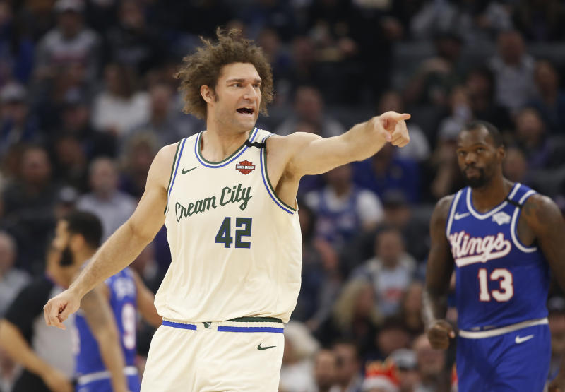 Milwaukee Bucks center Robin Lopez celebrates after the Bucks scored in the first quarter against the Sacramento Kings in an NBA basketball game on Sacramento, Calif., Friday, Jan. 10, 2020. The Bucks won 127-106. (AP Photo/Rich Pedroncelli)