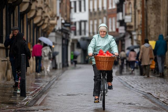 A woman cycling in Cambridge