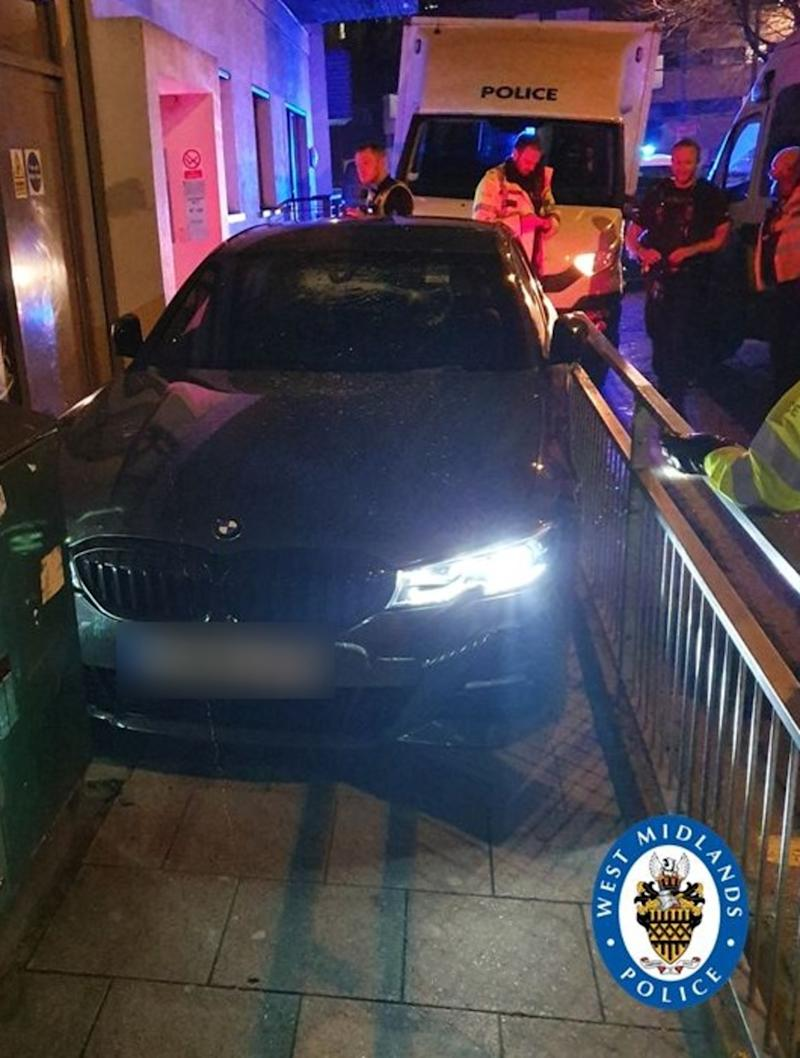 The BMW became pinned between railings