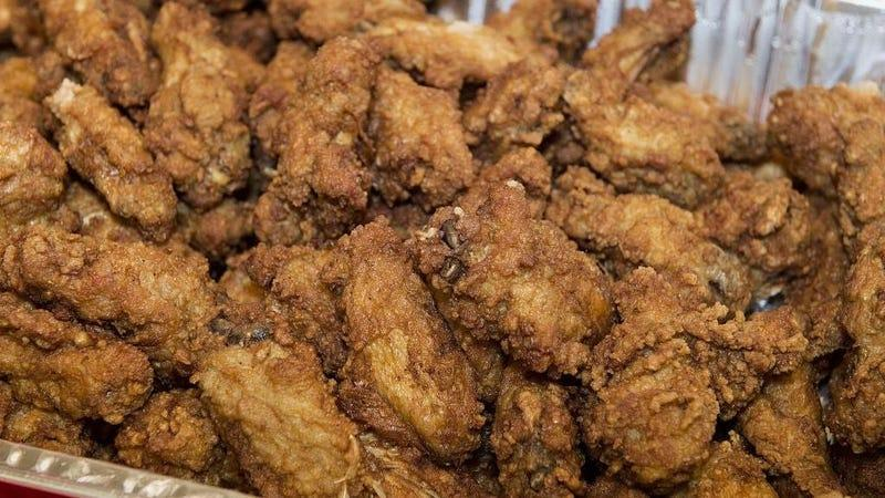 Tub of fried chicken wings prepared for wing eating contest