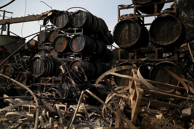 Charred wine barrels sit on racks at Paradise Ridge Winery after being destroyed by the Tubbs fire on Oct. 11  in Santa Rosa, Calif. (Photo: Justin Sullivan/Getty Images)