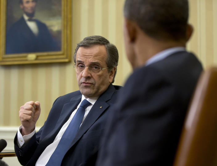 """President Barack Obama listens to Greek Prime Minister Antonis Samaras during their meeting in the Oval Office of the White House in Washington, Thursday, Aug. 8, 2013. The White House said the meeting will """"underscore ongoing support for Greece's efforts to reform its economy and promote a return to prosperity.""""(AP Photo/Pablo Martinez Monsivais)"""