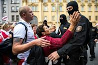 Some women took the black-clad riot police to task