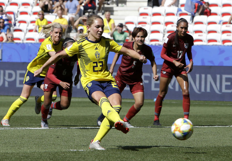 Sweden's Elin Rubensson scores her side's fifth goal by penalty during the Women's World Cup Group F soccer match between Sweden and Thailand at the Stade de Nice in Nice, France, Sunday, June 16, 2019. (AP Photo/Claude Paris)