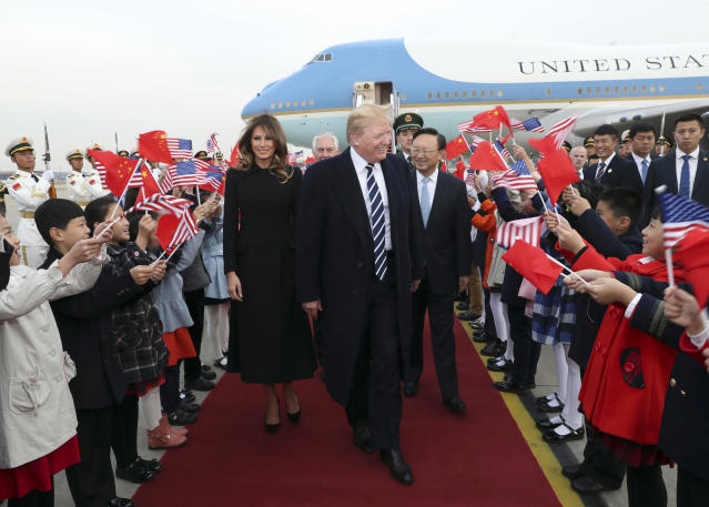 <p>Children wave U.S. and Chinese flags as President Donald Trump and first lady Melania Trump arrive at Beijing Airport, Wednesday, Nov. 8, 2017, in Beijing. (Photo: Pang Xinglei/Xinhua via AP) </p>