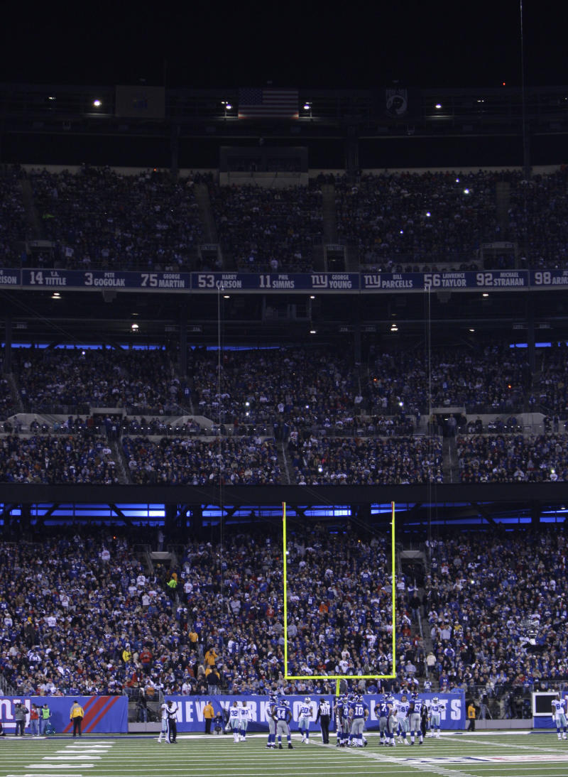 Some of the stadium lights are out during the third quarter of an NFL football game between the New York Giants and the Dallas Cowboys at New Meadowlands Stadium on Sunday, Nov. 14, 2010, in East Rutherford, N.J. Play was temporarily suspended. (AP Photo/Seth Wenig)