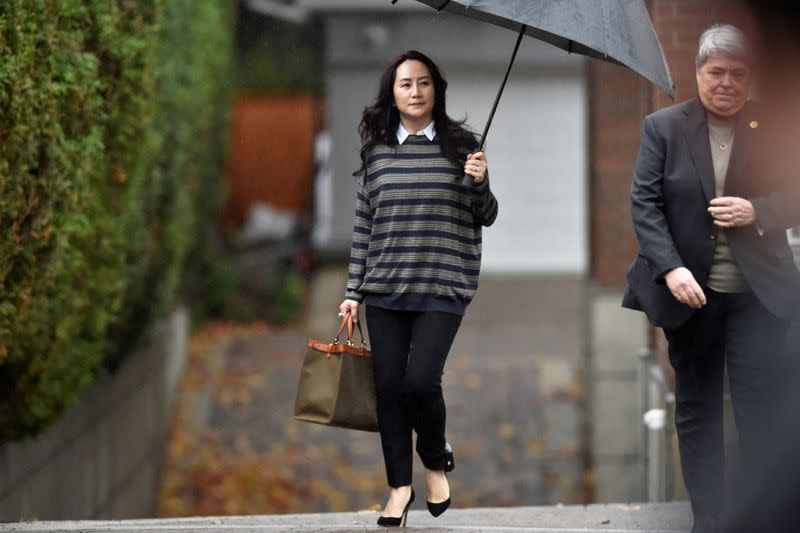 FILE PHOTO: Huawei Technologies Chief Financial Officer Meng leaves her home to attend a court hearing in Vancouver