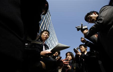A Japanese investor (C) speaks to the media as he protests against Mt. Gox, in front of the building where the digital marketplace operator was formerly housed in Tokyo February 26, 2014. REUTERS/Toru Hanai