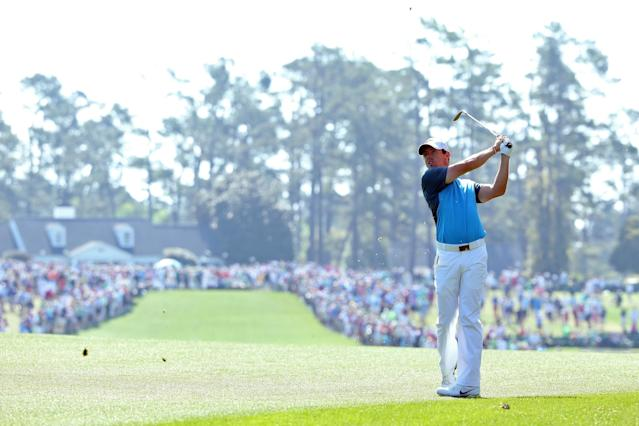 AUGUSTA, GA - APRIL 12: Rory McIlroy of Northern Ireland watches his approach shot on the first hole during the third round of the 2014 Masters Tournament at Augusta National Golf Club on April 12, 2014 in Augusta, Georgia. (Photo by Andrew Redington/Getty Images)