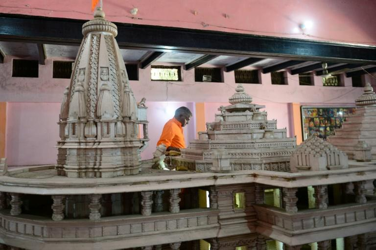 A model of the 'approved' temple is on display at the entry to the noisy workshop (AFP Photo/SANJAY KANOJIA)