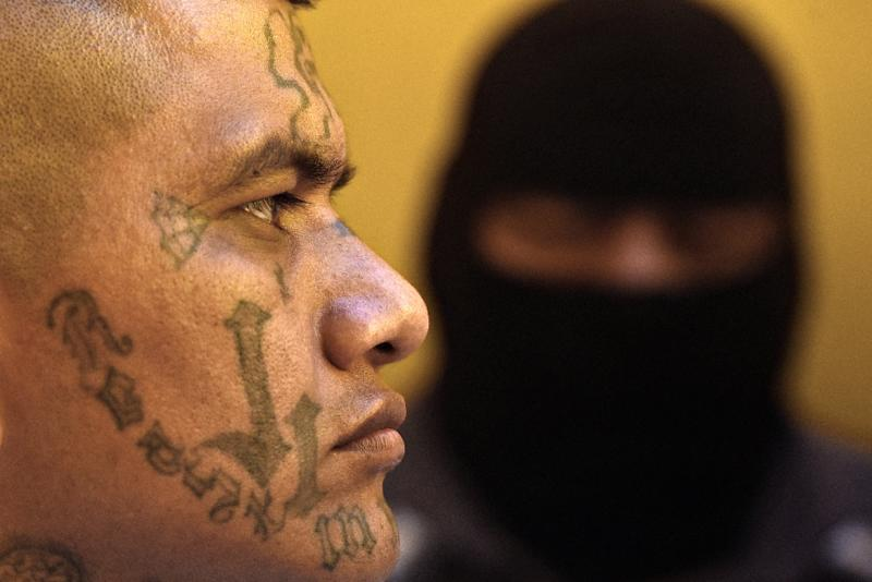 A former 18th Street gang member attends a Bible study class at San Francisco Gotera prison (AFP Photo/Marvin RECINOS)
