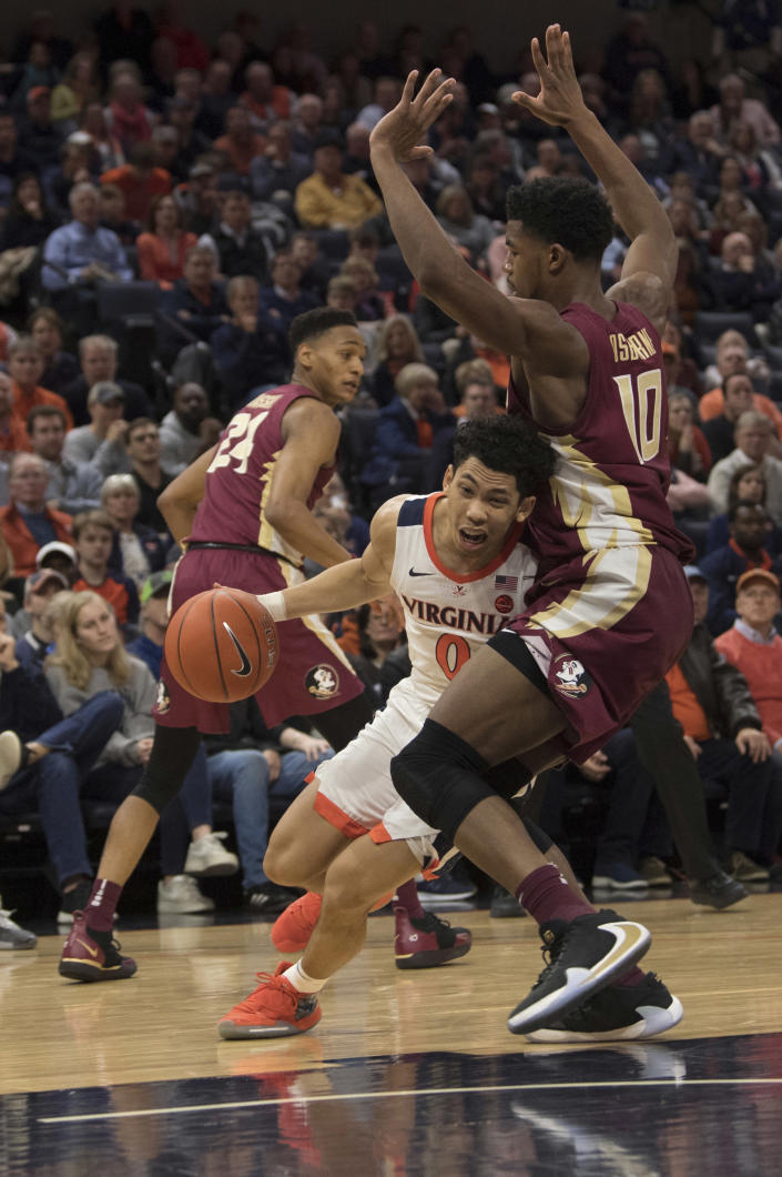 Virginia guard Kihei Clark (0) drives up against Florida State defender Malik Osborne (10) during the second half of an NCAA college basketball game in Charlottesville, Va., Tuesday, Jan. 28, 2020. (AP Photo/Lee Luther Jr.)