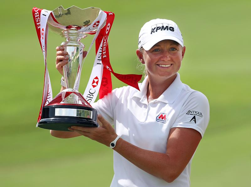 Stacy Lewis of the United States poses with the challenge trophy after winning the HSBC Women's Champions golf tournament on Sunday, March 3, 2013 in Singapore. (AP Photo/Wong Maye-E)