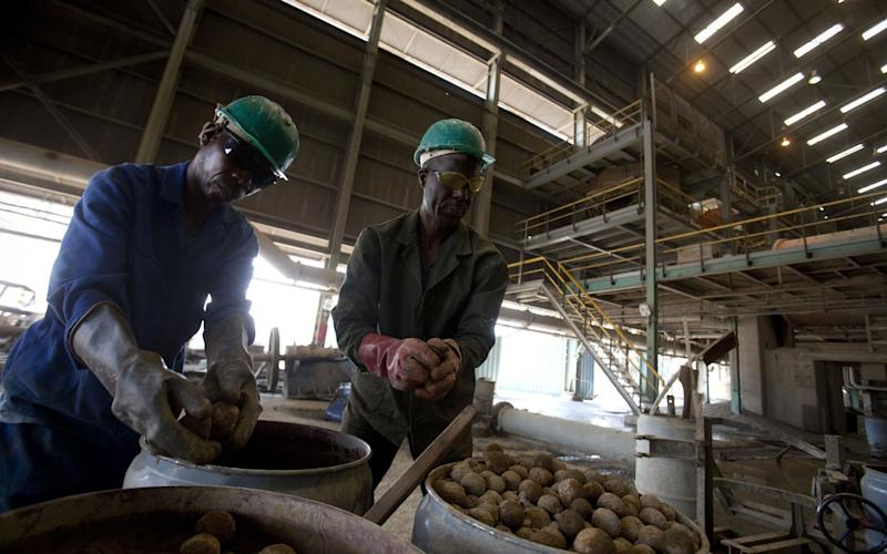 Workers at Katanga in the DRC.The FTSE 100 company has formed a board committee to respond to a DoJ investigation - Bloomberg