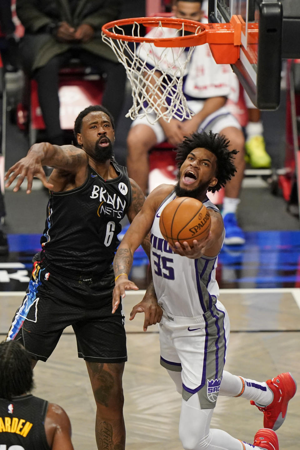 Brooklyn Nets center DeAndre Jordan (6) defends Sacramento Kings forward Marvin Bagley III (35) as Bagley goes up for a layup during the first quarter of an NBA basketball game, Tuesday, Feb. 23, 2021, in New York. (AP Photo/Kathy Willens)