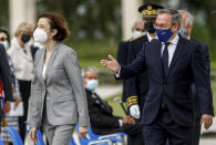 British ambassador to France, Edward Llewellyn, right, arrives with French Defense Minister Florence Parly for the inauguration of the British Normandy Memorial, in Ver-sur-Mer, France, Sunday, June 6, 2021. The monument, built under a project launched in 2016, pays tribute to those under British command who died on D-Day and during the Battle of Normandy. The names of more than 22,000 men and women, mostly British soldiers, are written on its stone columns. (Sameer Al-Doumy/Pool via AP)