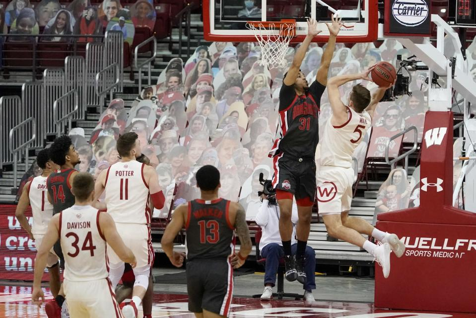 Wisconsin's Tyler Wahl shoots past Ohio State's Seth Towns during the second half of an NCAA college basketball game Saturday, Jan. 23, 2021, in Madison, Wis. (AP Photo/Morry Gash)