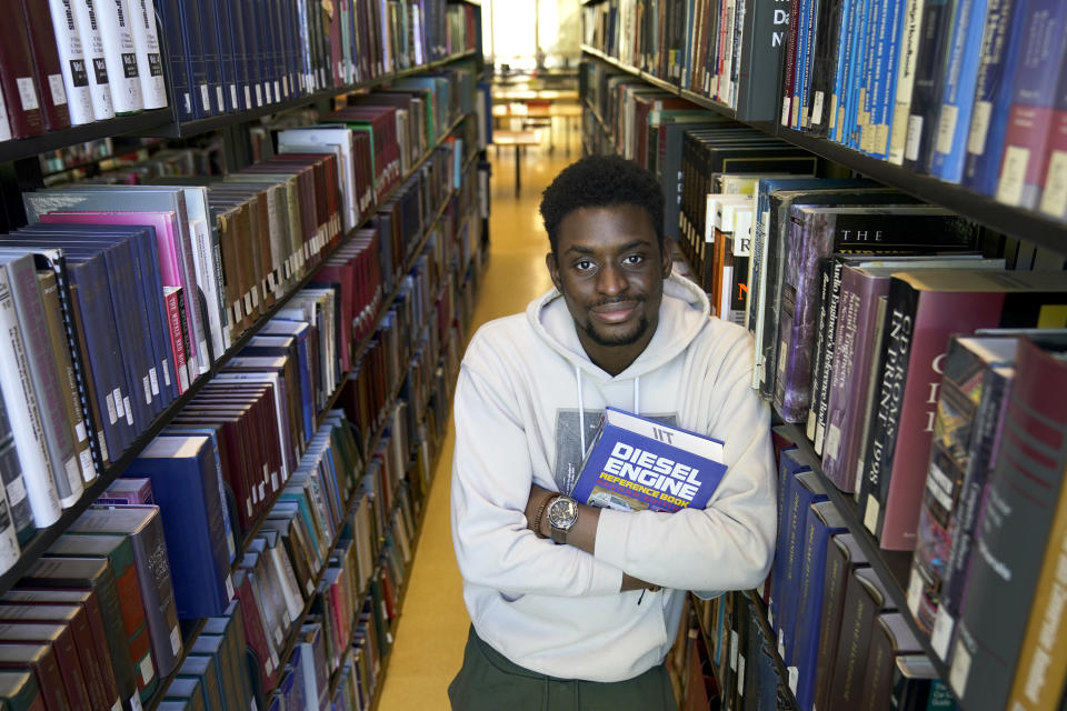 Illinois Institute of Technology student Wofai Ewa, originally from Nigeria, poses for a portrait Friday, Sept. 18, 2020, at the institute's library in Chicago. America was always considered the premiere destination for international students, with the promise of top-notch universities and work opportunities. Yet, 2016 marked the start of an alarming decline of new enrollees, something expected to continue with fresh rules limiting student visas, competition from other countries and a haphazard coronavirus response. (AP Photo/Charles Rex Arbogast)