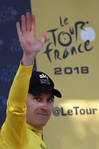 Britain's Geraint Thomas, wearing the overall leader's yellow jersey, celebrates on the podium after the fifteenth stage of the Tour de France cycling race over 181.5 kilometers (112.8 miles) with start in Millau and finish in Carcassonne, France, France, Sunday July 22, 2018. (AP Photo/Christophe Ena)