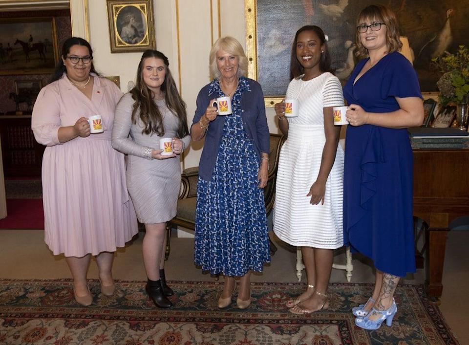 Camilla and her guests enjoyed a cup of tea (Eddie Mulholland/Daily Telegraph) (PA Wire)