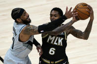 Atlanta Hawks guard Lou Williams (6) is defended by Portland Trail Blazers forward Carmelo Anthony (00) as he looks for an opening in the first half of an NBA basketball game Monday, May 3, 2021, in Atlanta. (AP Photo/John Bazemore)