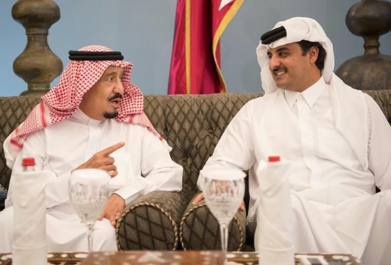 Saudi King Salman chats with Qatari emir Sheikh Tamim bin Hamad al-Thani in Doha in December 2016, six months before the Gulf crisis erupted