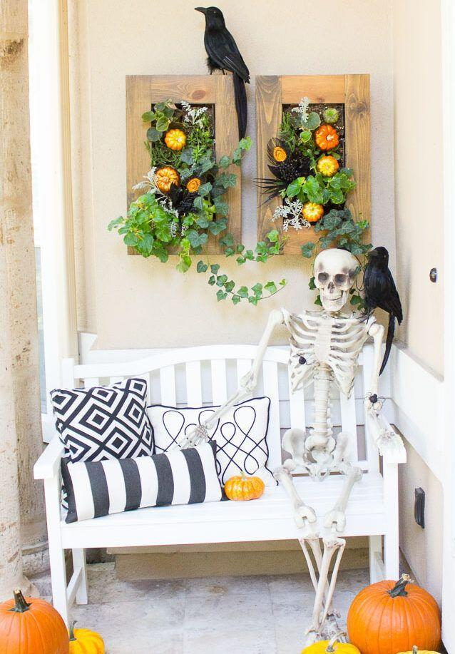 "<p>If you've got a bench or rocking chair — or even just a tall stack of pumpkins — sit a skeleton down and affix a crow to his shoulder. You can even put a bowl of candy on the skeleton's lap if you'd like. </p><p><em><a href=""https://designimprovised.com/2015/10/5-steps-to-spooky-halloween-front-porch.html"" rel=""nofollow noopener"" target=""_blank"" data-ylk=""slk:Get the tutorial at Design Improvised »"" class=""link rapid-noclick-resp"">Get the tutorial at Design Improvised »</a> </em></p>"