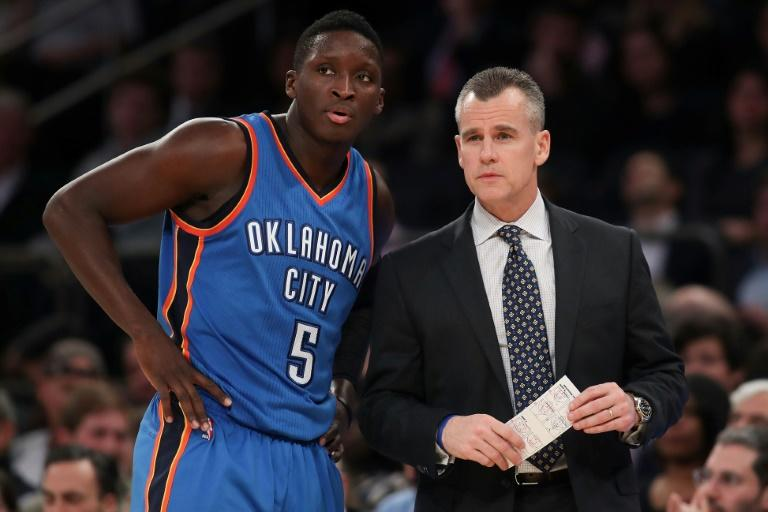 The Oklahoma City Thunder point guard Victor Oladipo and head coach Billy Donovan watch a NBA game at Madison Square Garden in New York